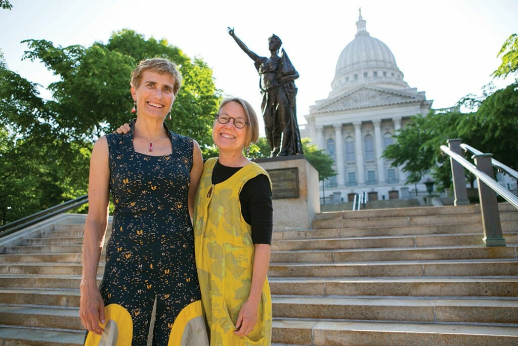 Brenda Baker and Bird Ross stand in front of the Wisconsin State Capitol Forward stature
