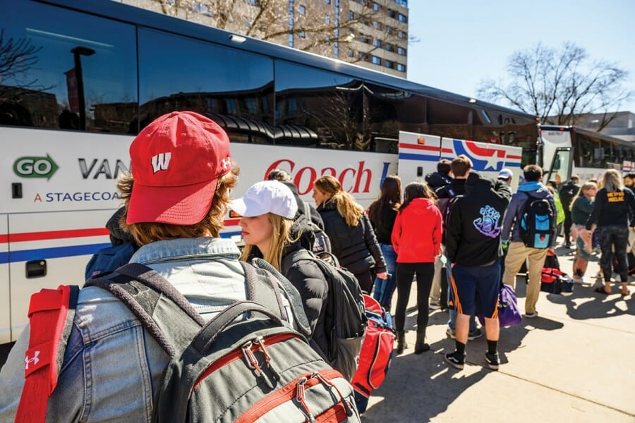 Students board buses to leave campus on March 13.