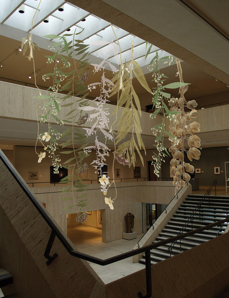 Embroidery installation hung from the Chazen gallery ceiling