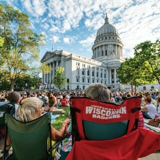 Spectators watch a performance on the Wisconsin state Capitol lawn