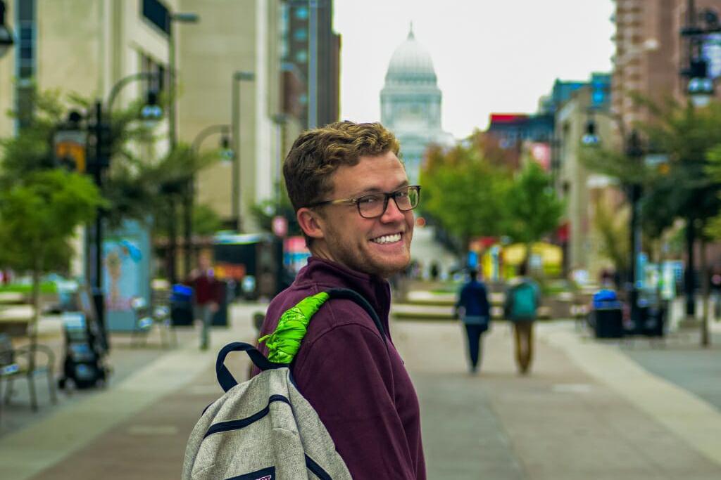 Conlin Bass sports a green bandana on his backpack