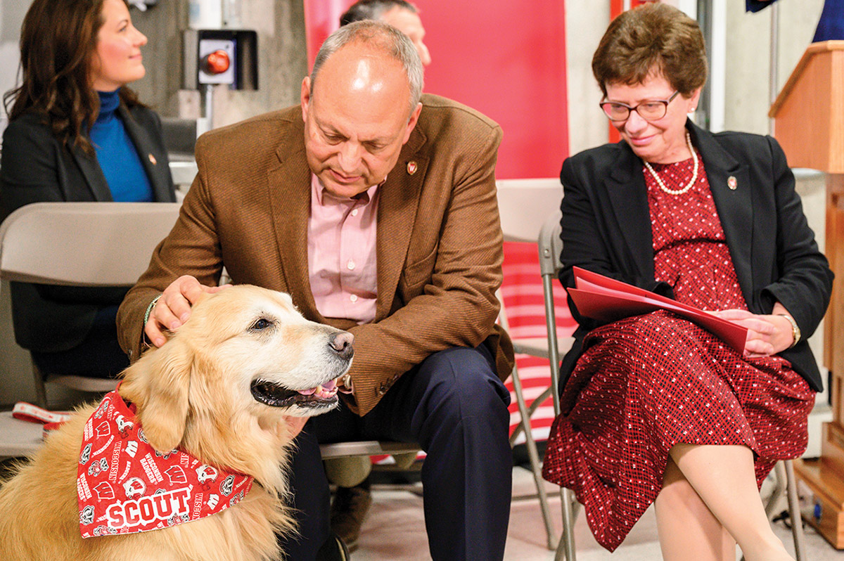 WeatherTech founder and CEO David MacNeil with his dog Scout and UW chancellor Rebecca Blank