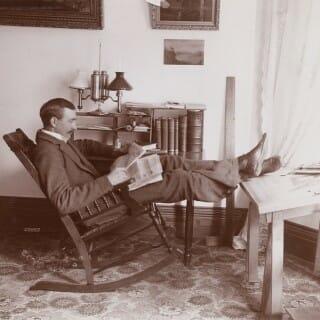 Edward Schildhauer reading newspaper