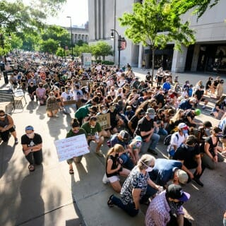 Protesters kneel near Memorial Library