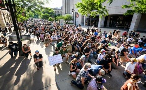 Protesters kneel near Memorial Library