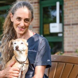 Sandra Newbury holding a dog