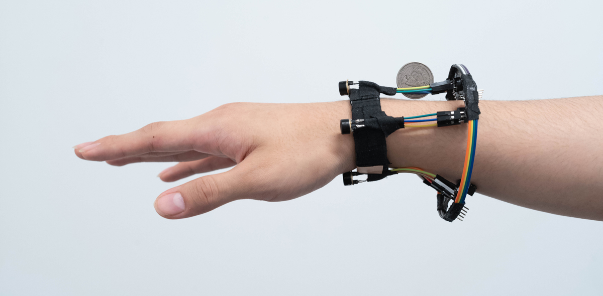 A person's hand modeling a 3-D tracking wristband