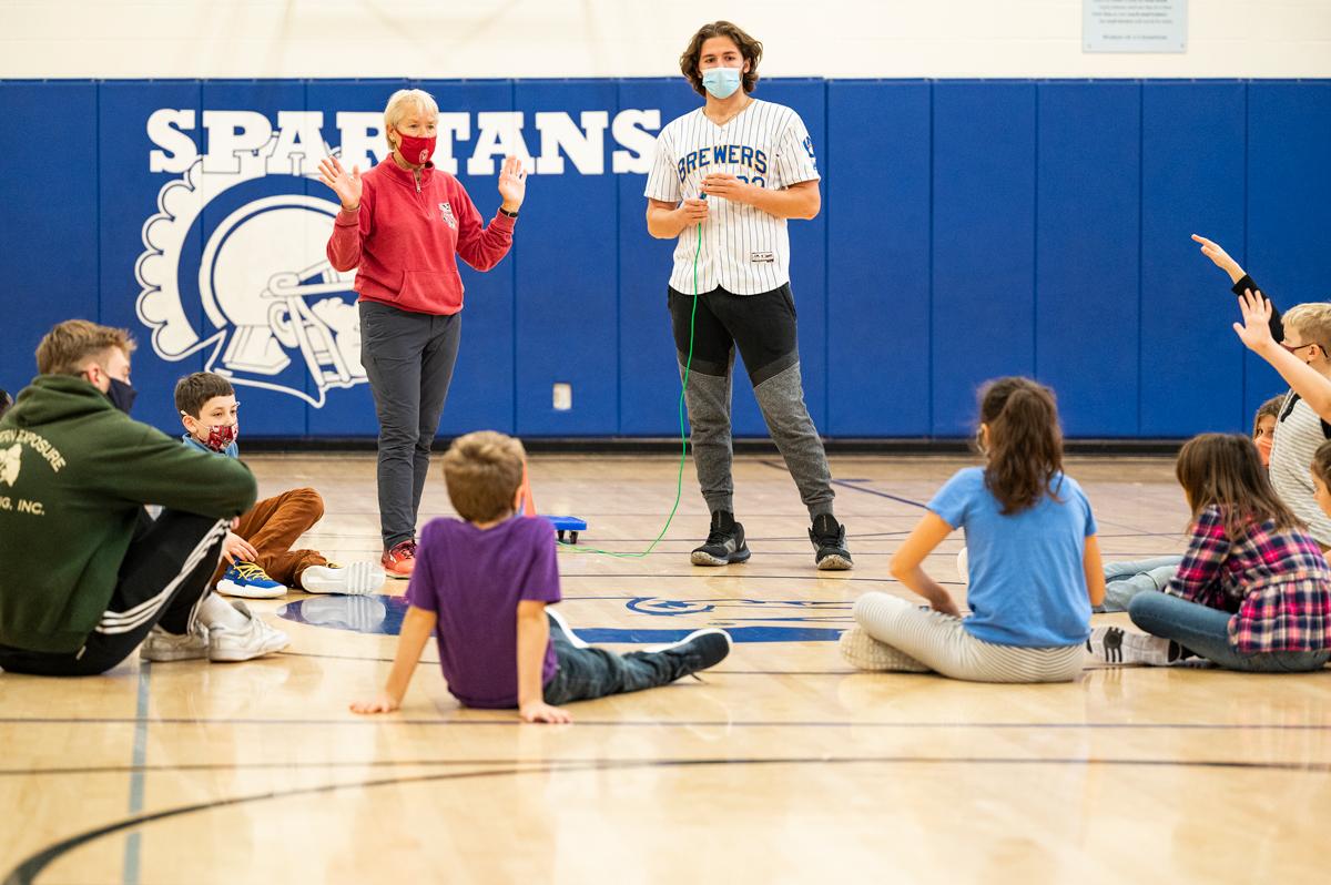 Physical Education teacher and student teacher instruct a grade school class