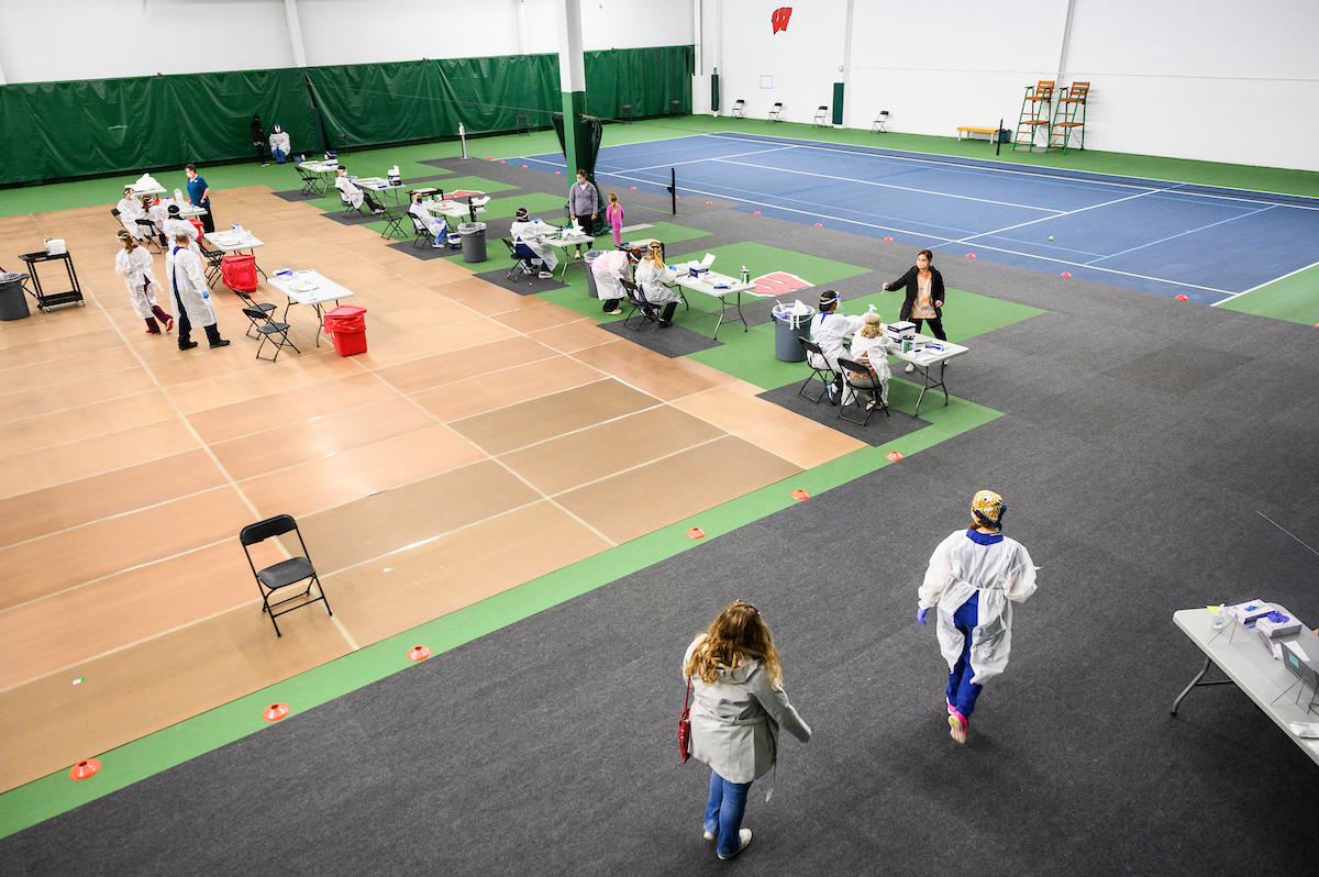 Members of the Madison community receive COVID-19 testing at the Nielsen Tennis Center