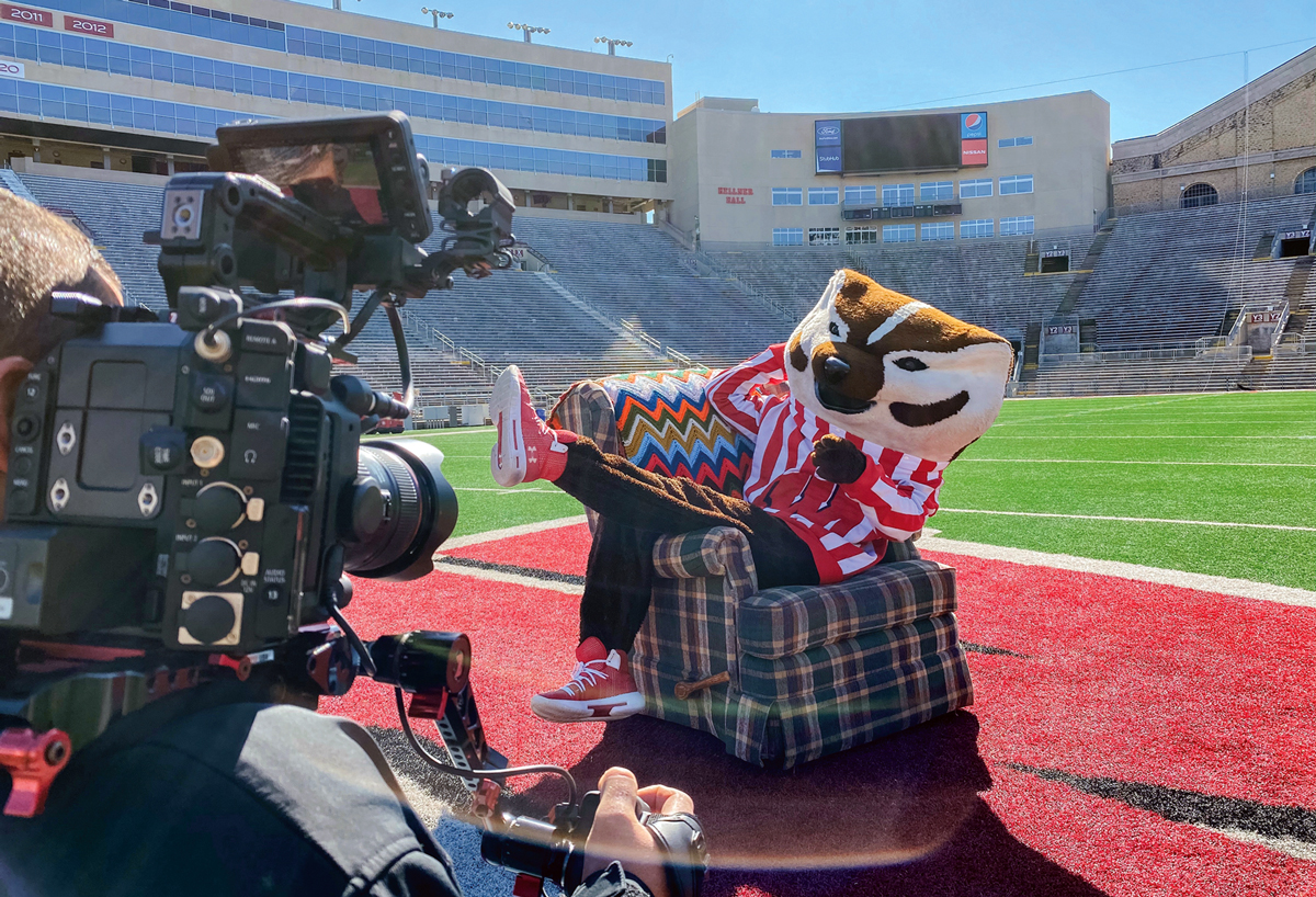 Bucky Badger poses for video camera on Camp Randall Field