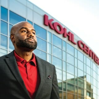 Mike Jackson in front of the Kohl Center