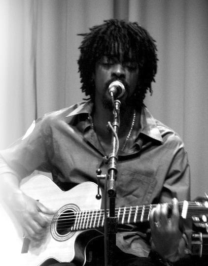 Seu Jorge playing guitar