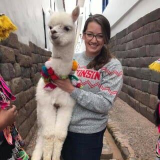 Katie Lorenz holding an alpaca