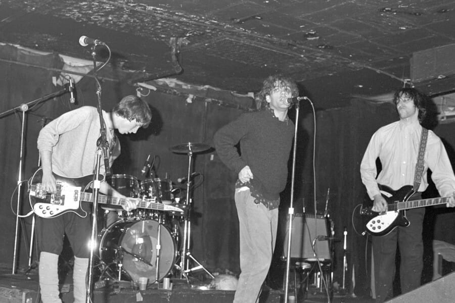 Black and white photo of R.E.M. performing at Merlyn's in 1981