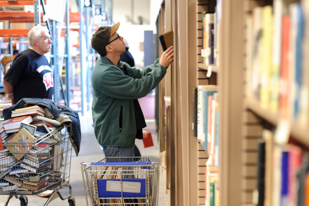 Customer browses selection of used items at UW Swap