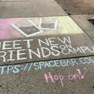 "Sidewalk chalk writing reads, ""Meet new friends on campus"""