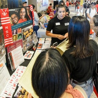 Students check out the Multicultural Student Center booth during the Fall Student Organization Fair at the Kohl Center at the University of Wisconsin-Madison