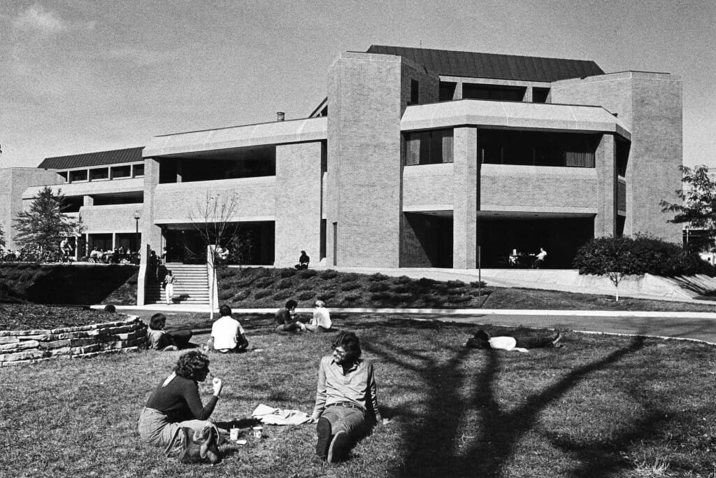 Black and white photo of students outside the old Union South during the 1970s