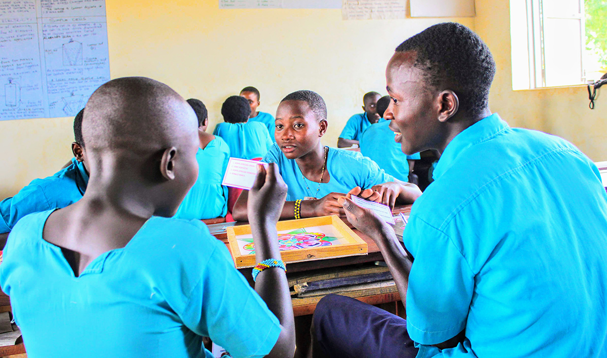 Refugee students playing board game