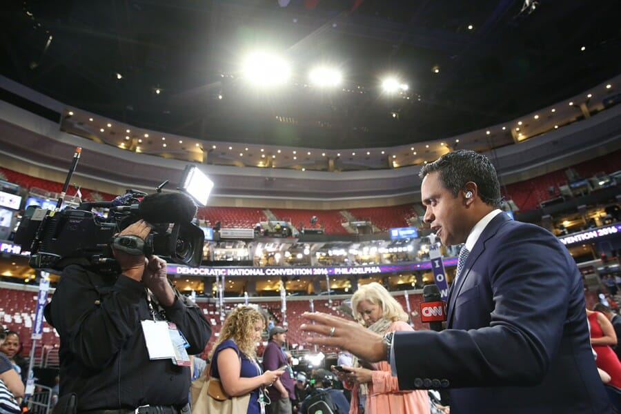 Manu Raju in front of news camera at the 2016 Democratic National Convention