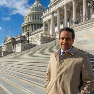 Manu Raju in front of the U.S. Capitol building