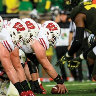 Close-up photo of Badger football players on the field