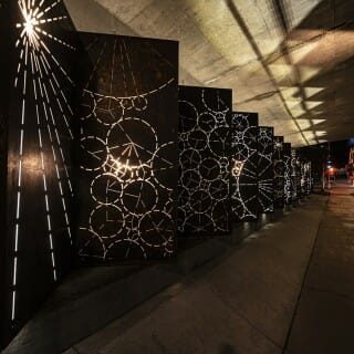 'Shift' a public art installation designed by artist Julia Schilling comprised of two 70-foot metal light sculptures located in the underpass beneath University Avenue at Highland Avenue