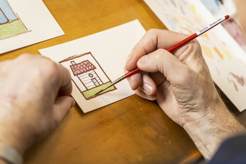Close up of Kevin Henke's hands as he draws