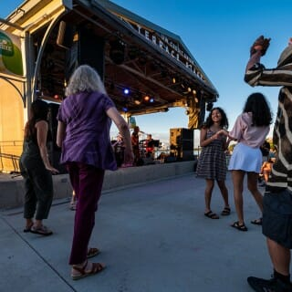 Terrace patrons dance to live music