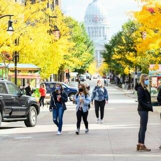 Pedestrians walk through Library Mall in the Autumn