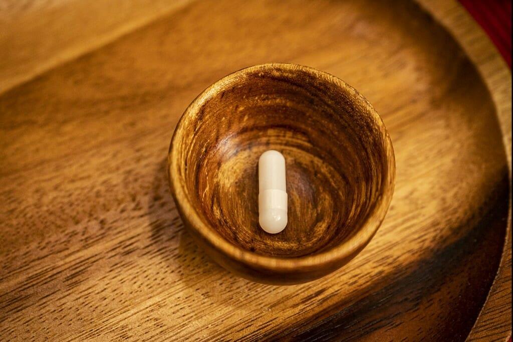 A pill capsule in a dish